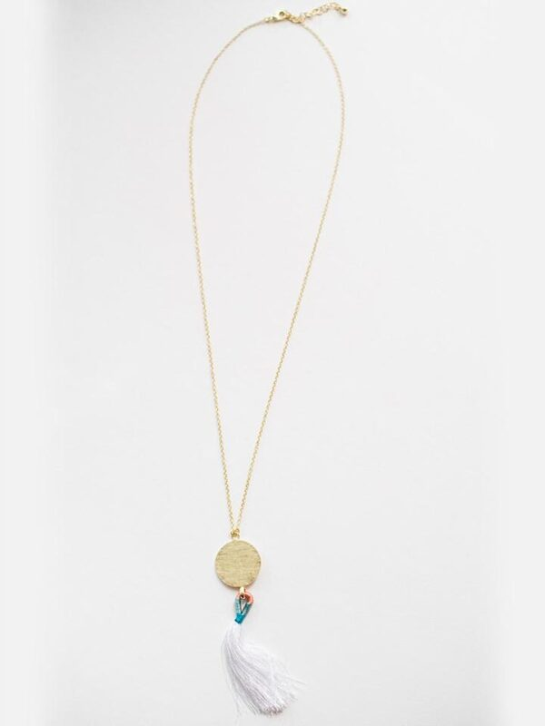 Ethically-sourced round pendant with cotton thread tassel and necklace made of brass.