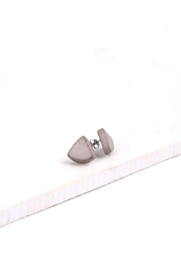 A pair of triangle shaped stud earrings made of tagua.