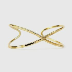 Ethically-sourced Infinity Cuff made with Brass-plated recycle metal in white background.