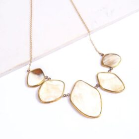 Stunning upcycled 5 piece brass encased white pendant with 18 inches gold-colored brass chain in white background.