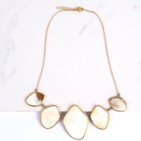 Adorable upcycled necklace in white background.