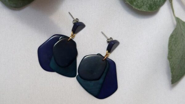 Ethically-sourced Orange Estate Blue treasure dangling earrings design with three overlapping pieces mimicking petals.