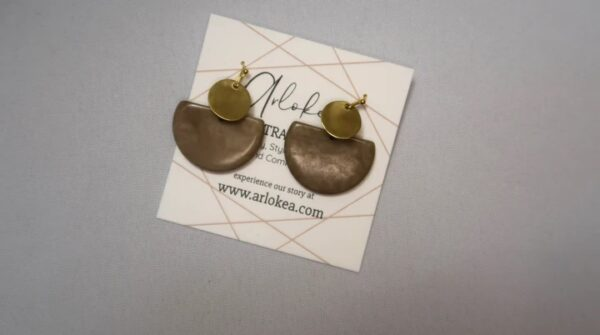 Environmentally friendly dangling Tagua Disc Earrings Made with half circle Opal Gray Tagua and gold-colored round brass.