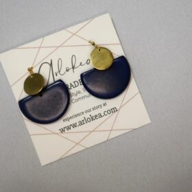 Environmentally friendly dangling Tagua Disc Earrings Made with half circle Blue Tagua and gold-colored round brass.