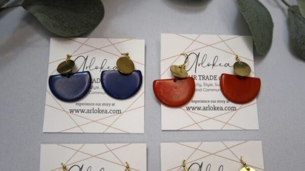 Blue and Red Tagua Disc Earrings placed side by side.