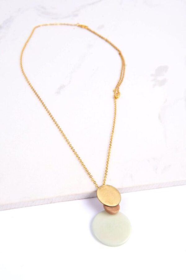 Environmentally friendly Overlapping Dewkist Tagua Disc Pendant and adjustable brass chain.