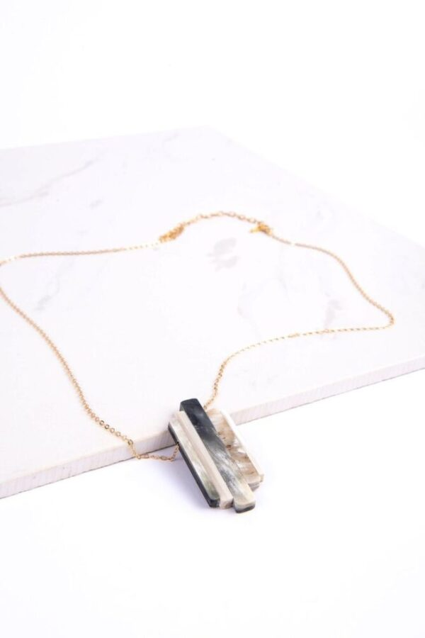 Ethically made Taipei Necklace of 5 parts upcycled material expertly arranged pendant and adjustable gold colored chain.