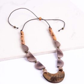 Ethically-made adjustable Wildness Necklace made with different stones and seeds.